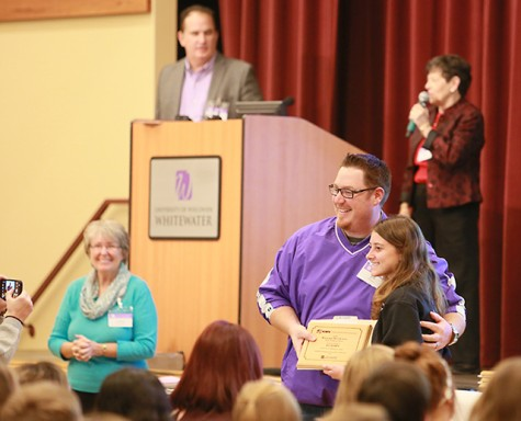 Jeff Willauer presents All-KEMPA award to the Purple Sage newspaper editor from Waunakee High School.