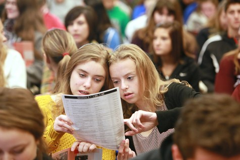 Students check the day's schedule.